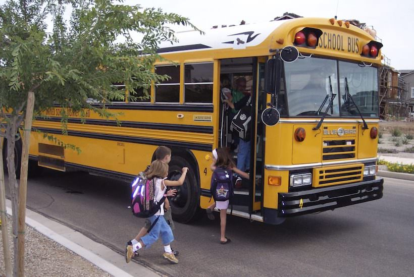 Kids getting on the school bus. First day of school 2005.